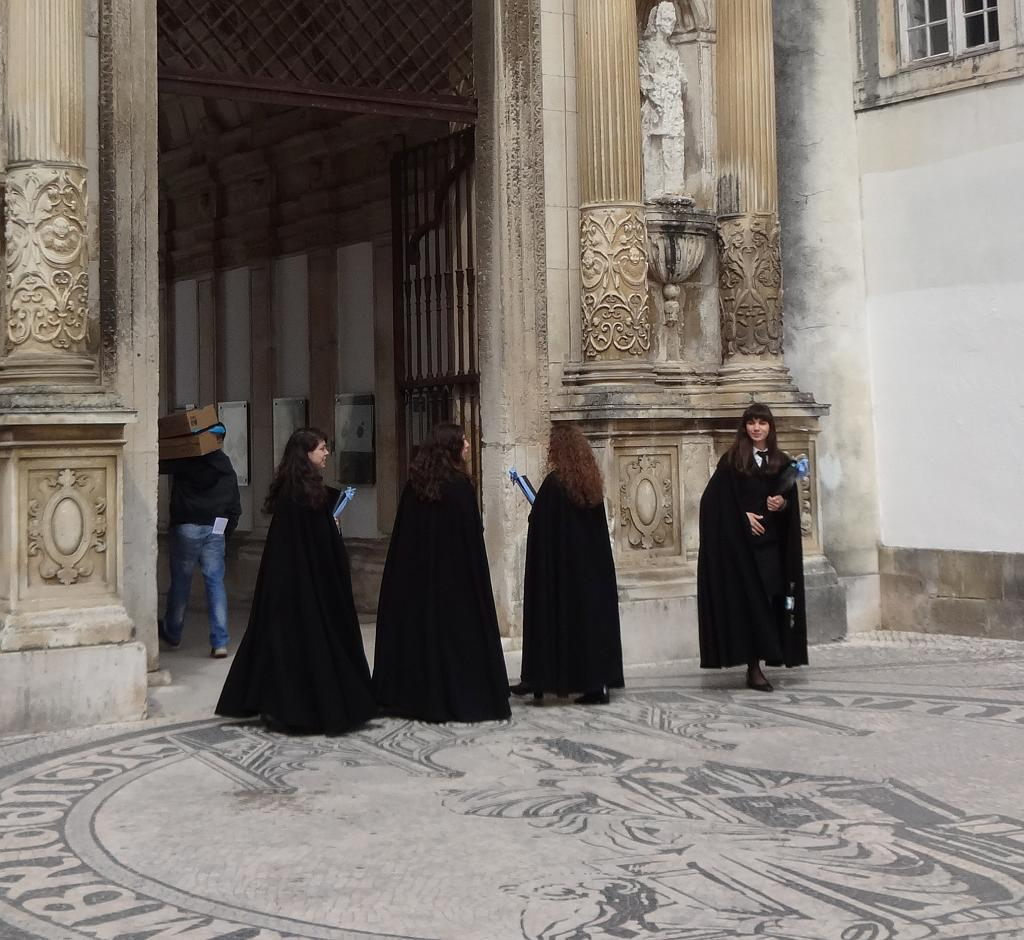 Coimbra graduating students in traditional black capes