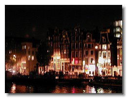 Amstel canal houses at night