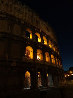 photo of Roman Colosseum at night by Rebecca Snyder